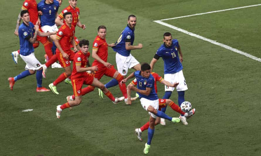 Italy's Matteo Pessina, foreground, scores his side's only goal.