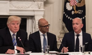 Awkwaaaarrddd. In this file photo taken on June 19, 2017 t Donald Trump (L) and Microsoft CEO Satya Nadella (C) listen to Amazon CEO Jeff Bezos (R) during an American Technology Council roundtable at the White House.