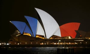 The blue, white and red colours of France's national flag are projected onto the sails of Sydney's Opera House.