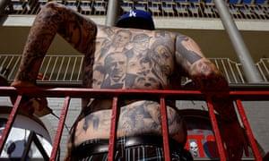 A tattood man on the boardwalk in Venice California