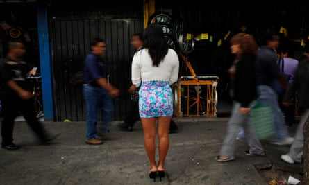 A sex worker waits for clients in downtown Mexico City.