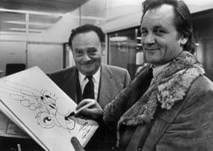 French comic book artists Albert Uderzo (R) and René Goscinny (L) pose with a drawing of their characters Asterix.
