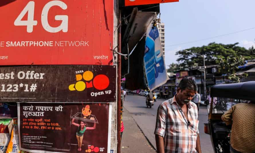 Advertisements for telecom operators at a store in Mumbai, India