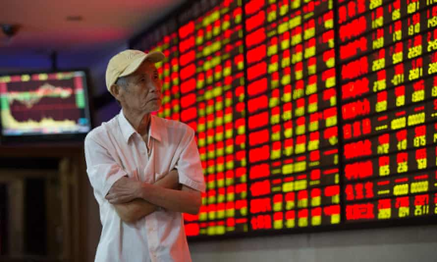 An investor watches the stock market plunge in Shanghai.