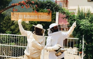 Ali and Aysin in their beekeeping suits