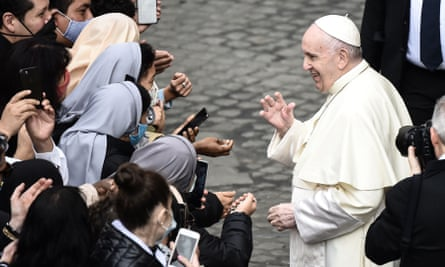 Pope Francis blesses nuns as he leaves after holding a limited public audience at the San Damaso courtyard in the Vatican on 30 September.