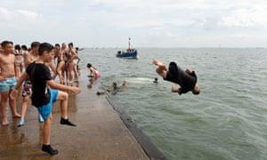 boy diving sea Thames estuary at Leigh-on-Sea