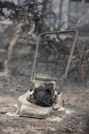 A burnt lawn mower at destroyed by burnt out houses on Railway Parade, Wingello.