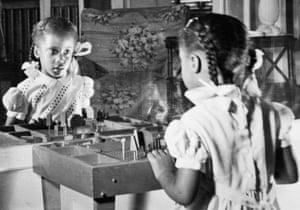Denise reflecting on her image, circa 1951.