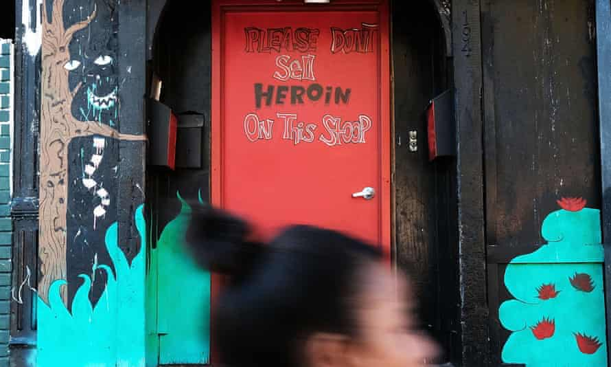A door is painted with a message on a street in a neighborhood with a high rate of illegal drug use on 14 October 2016 in New York City.