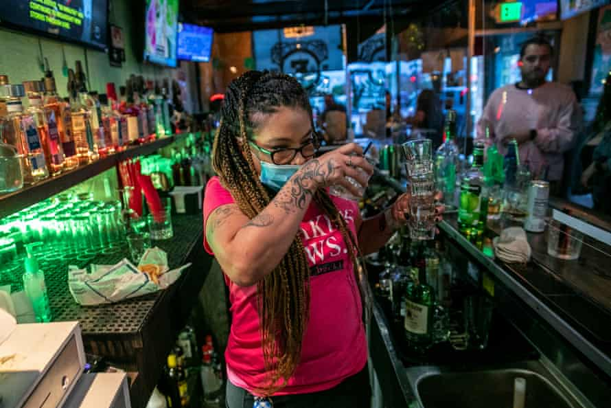 Bartender Christina Flintland serves drinks at Elvies Public House. Governor Newsom ordered bars to close as Covid-19 cases surge in California.