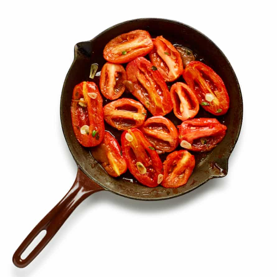 Lay the tomatoes in cut side up.