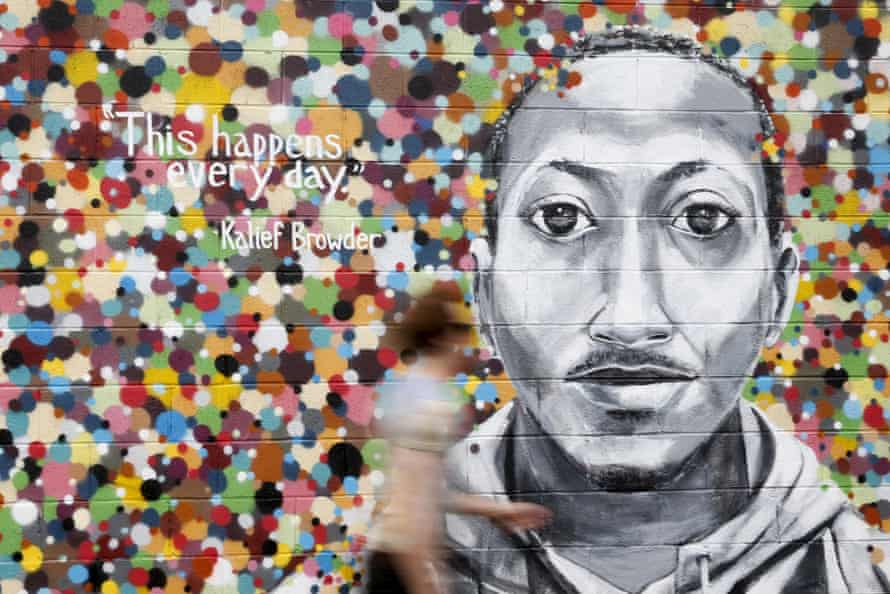 A man walks by a mural honoring Kalief Browder in the Astoria section of the Queens borough of New York.