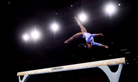 Simone Biles completed a twisting double tuck dismount to win gold in the beam balance final.