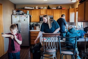 Jessica Rebeschini, 26, with her sons Karter, 4, Chase, 7, and her husband Ron, 34 in their home in Boundurant, IA on December 22, 2019.