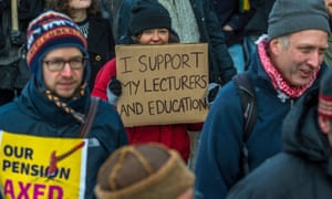 A protester holds a placard in support of lecturers at a pensions strike in London this week
