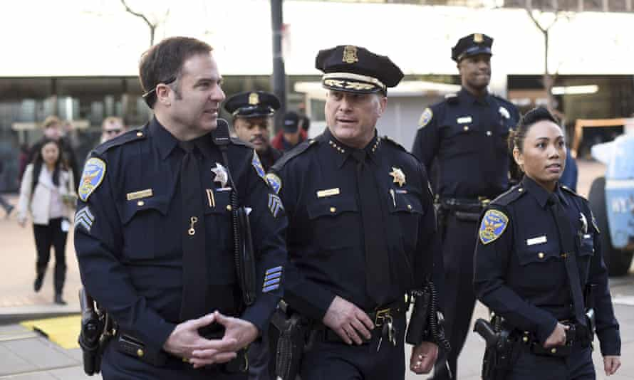 Earlier in the year, a judge ruled that San Francisco police chief Greg Suhr, center, waited too long to discipline officers who he discovered had exchanged racist and homophobic text messages.