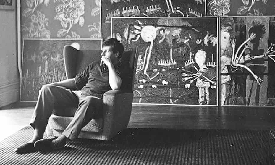 David Storey at home in Belsize Park, London, 1961, with his paintings in the background.