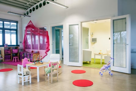 Playroom looking into an interview room run by Triangle, an organisation that helps children give evidence.