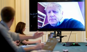 Boris Johnson chairs a Covid-19 meeting remotely