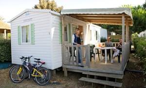 Wooden chalet accommodation at Les Peupliers campsite on Île de Ré, France.