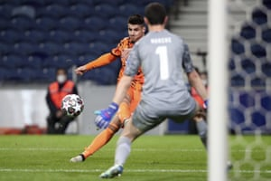Juventus' Alvaro Morata attempts a shot at goal but is thwarted by Porto's goalkeeper Agustin Marchesin.