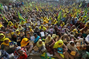Relatives of farmers who are believed to have killed themselves over debt attend a protest in Delhi, India