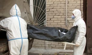 Health workers bring a body to a hospital morgue in the city of Barnaul
