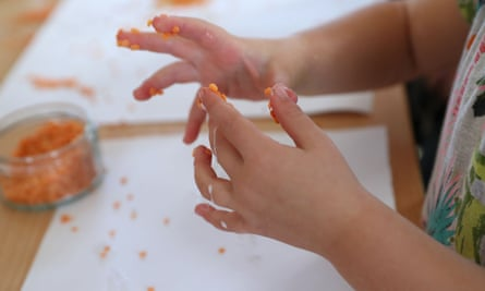 Children at a nursery near Bournemouth use lentils and rice as glitter substitutes after the ban.
