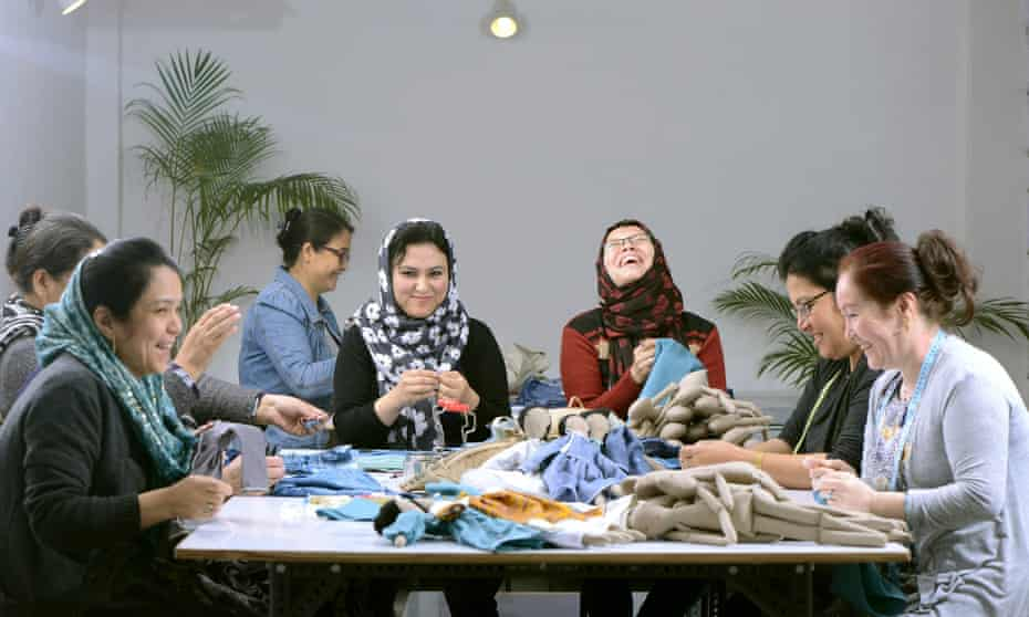 Afghan refugees in India creating dolls from leftover fabric