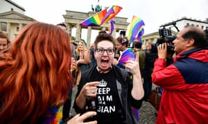 People celebrate the legalisation of same-sex marriage in front of the Brandenburg Gate in Berlin.