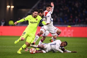 Barcelona's Lionel Messi gets the better of Lyon's Lucas Tousart (centre left), Houssem Aouar (centre right) and Marcelo (right).