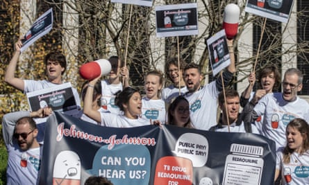 Demonstrators rally to lower the price of a tuberculosis drug outside the Johnson & Johnson campus in Zug, Switzerland, on 17 October.