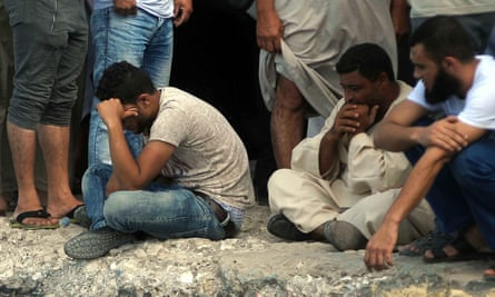 Relatives of people missing after the shipwreck await news on the quayside in Rosetta, Egypt