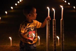 A child lights a candle at the Madan Mohan Malviya stadium in Allahabad, India