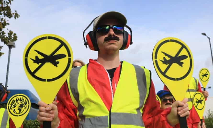 Protestors from Extinction Rebellion's 'Landing Crew' outside London City airport.