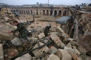 Syrian pro-government forces walking in the ancient Umayyad mosque