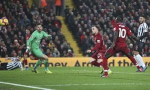 Xherdan Shaqiri fires in Liverpool's third.