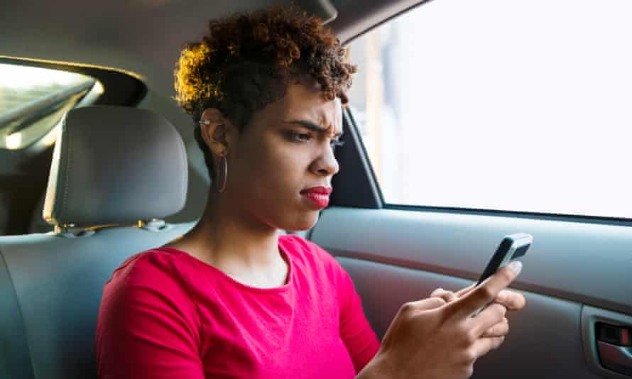 Annoyed Millennial Passenger Makes a Face while Texting