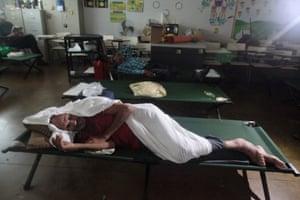 People take shelter in a school in Fajardo.