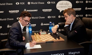 Magnus Carlsen and Fabiano Caruana at the start of the first of 12 world championship games. It ended in a draw after seven hours.