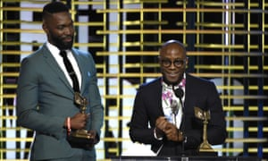 Tarell Alvin McCraney and Barry Jenkins accept the award for best screenplay for Moonlight.