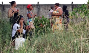 Relatives of inmates wait for information outside the prison in Boa Vista, Brazil, on Friday.