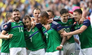 Northern Ireland celebrate after Niall McGinn's late goal.