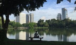 Contemplating the view in Bangkok's Lumphini Park.