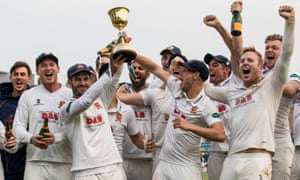 Essex celebrate with the First Division Championship trophy at Chelmsford in September - their first top flight title since 1992.