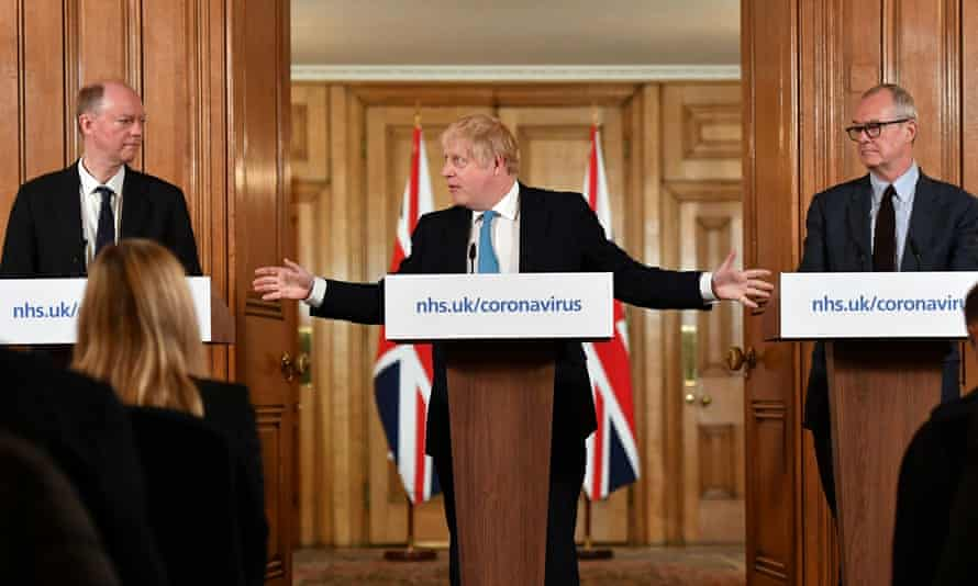 Chief medical officer Chris Whitty and chief scientific adviser Patrick Vallance flank Boris Johnson at a Covid press conference on 19 March, 2020.