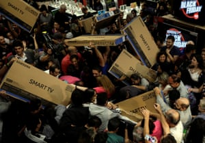 Sao Paulo, Brazil Shoppers reach out for television sets