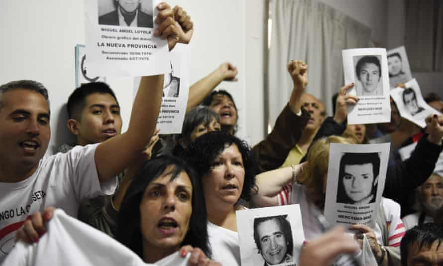 Family members of ex-Ford Motor Co employees watch the sentencing of former executives in Buenos Aires, Argentina, on 11 December.