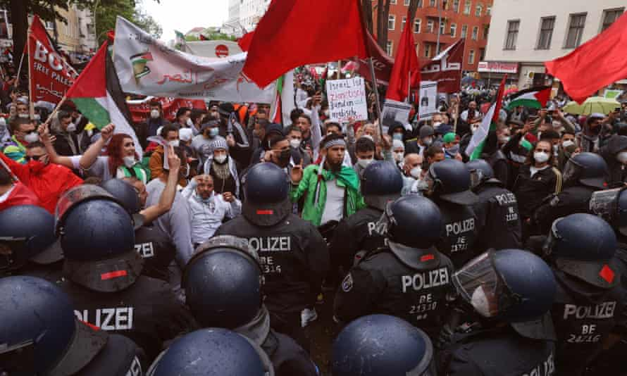 Riot police face protesters in the Neukölln district in Berlin